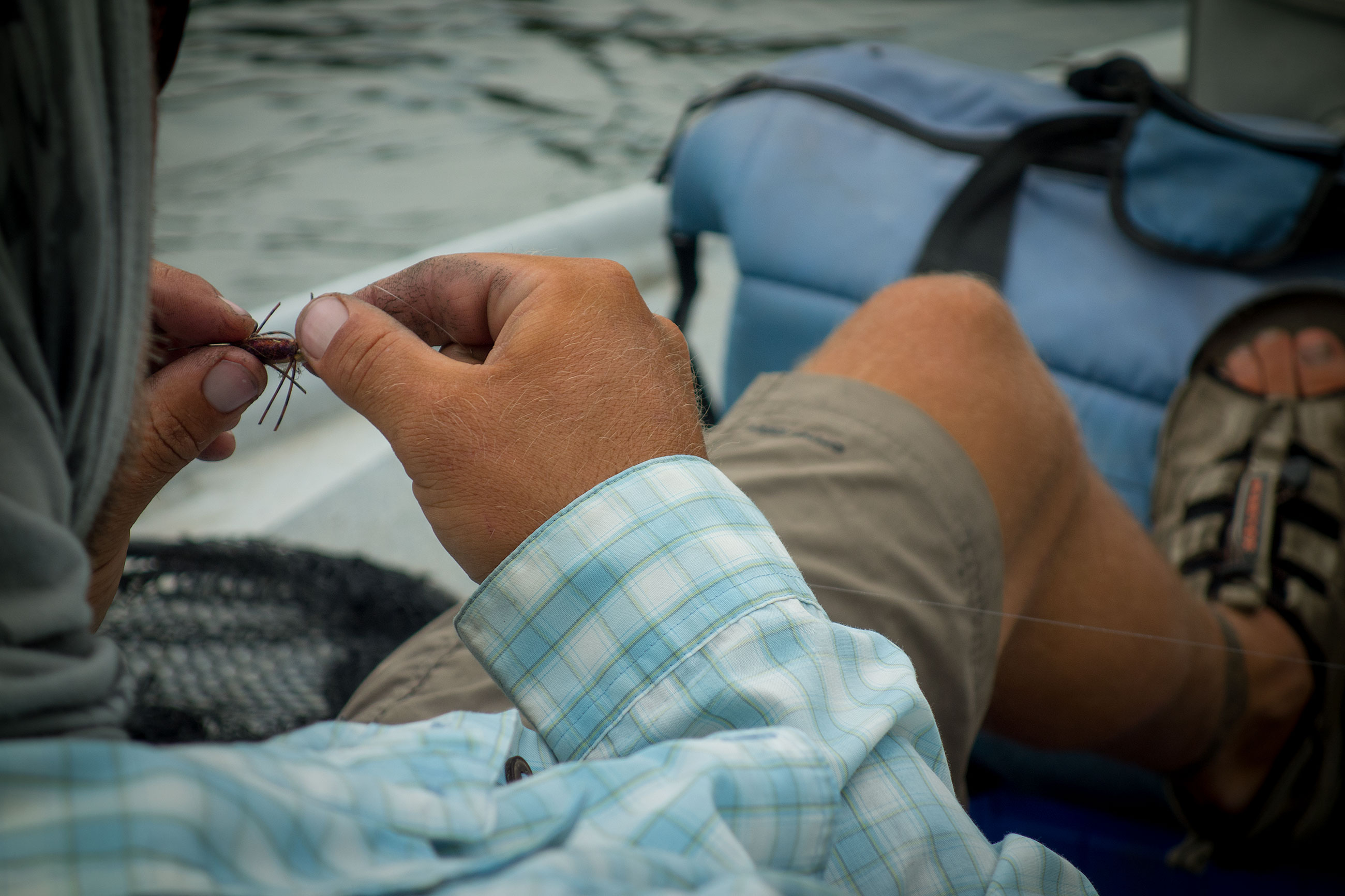 Guides are the same the world over. Even when they have other guides in the boat they prefer to tie all their own knots!